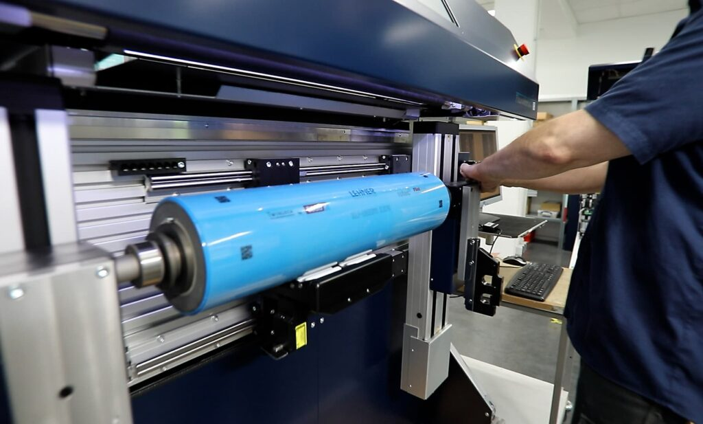 Flexo plate mounting.png – FlexoMatrix handles plates and sleeves with equal ease